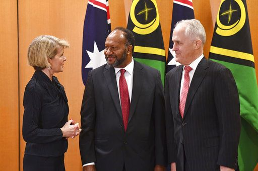 Vanuatu Prime Minister Charlot Salwai Tabimasmas, center, meets with Australian Prime Minister Malcolm Turnbull, right, and Australia's Minister for Foreign Affairs Julie Bishop, before a bilateral meeting at Parliament House in Canberra, Monday, June 25, 2018. Australia said it would negotiate a security treaty with Vanuatu, weeks after Turnbull warned China against building a military base on the South Pacific island nation. (Mick Tsikas/AAP Image via AP)