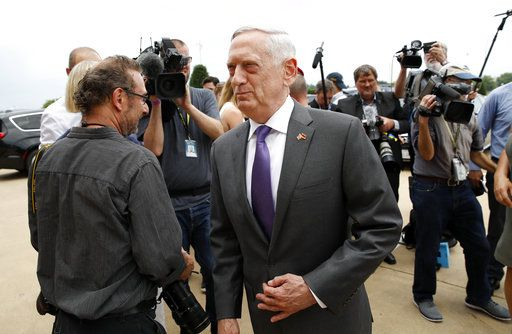 FILE - In this Wednesday, June 20, 2018, file photo, U.S. Defense Secretary Jim Mattis steps away after speaking with the media at the Pentagon, in Washington. Speaking to reporters on his plane en route to a stop in Alaska, Sunday, June 24, Mattis laid out plans for a less contentious, more open dialogue with Chinese leaders as he travels to Asia, less than a month after he slammed Beijing at an international conference for its militarization of islands in the South China Sea.