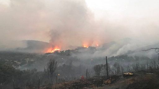 In this photo provided by the California Department of Forestry and Fire Protection, the Pawnee Fire wildfire burns in the Spring Valley area, northeast of Clearlake Oaks in Lake County, Calif., early Sunday, June 24, 2018. The Pawnee Fire, which broke out Saturday near Clearlake Oaks, was one of four wildfires burning in largely rural areas as wind and heat gripped a swath of California from San Jose to the Oregon border. (Jonathan Cox/California Department of Forestry and Fire Protection via AP)