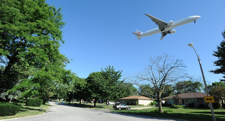 Low-flying jets prepare to land at O'Hare International Airport over Bensenville. The O'Hare Noise Compatibility Commission is seeking to reduce overnight noise with new strategies.