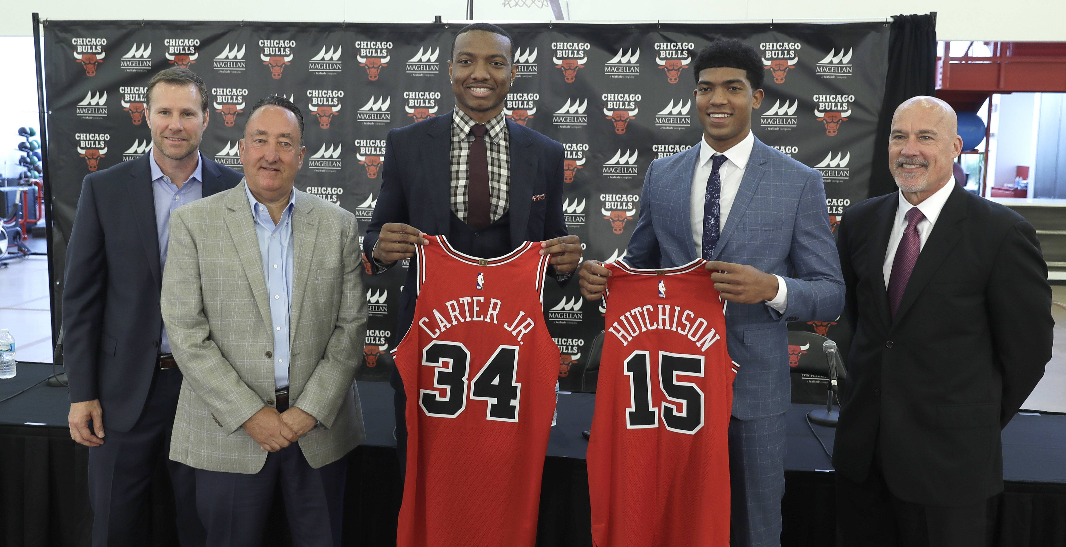 Chicago Bulls draft picks Wendell Carter Jr., (34) and Chandler Hutchison (15) share the stage with team executive from left, head coach Fred Hoiberg, general manager Gar Forman and executive vice president for basketball operations John Paxson.