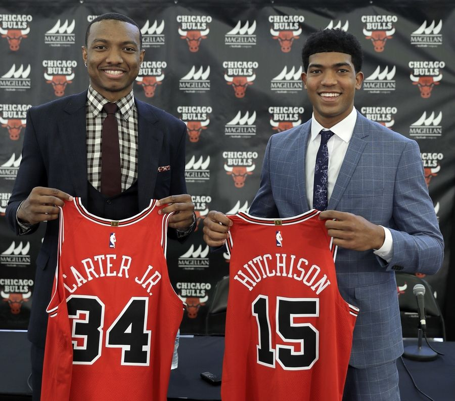 Wendell Carter Jr., left, and Chandler Hutchison, both first-round draft picks of the Chicago Bulls, pose with their jerseys Monday after meeting with the media Monday in Chicago.