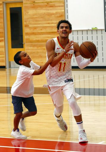 Atlanta Hawks NBA basketball team first-round draft pick Trae Young plays with his eight-year-old brother, Timothy, after a news conference Monday, June 25, 2018, in Atlanta.