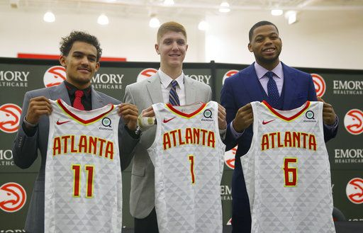 Atlanta Hawks NBA Draft first-round draft picks Trae Young (11), Kevin Huerter (1) and Omari Spellman (6) pose with their jerseys during a news conference Monday, June 25, 2018, in Atlanta.