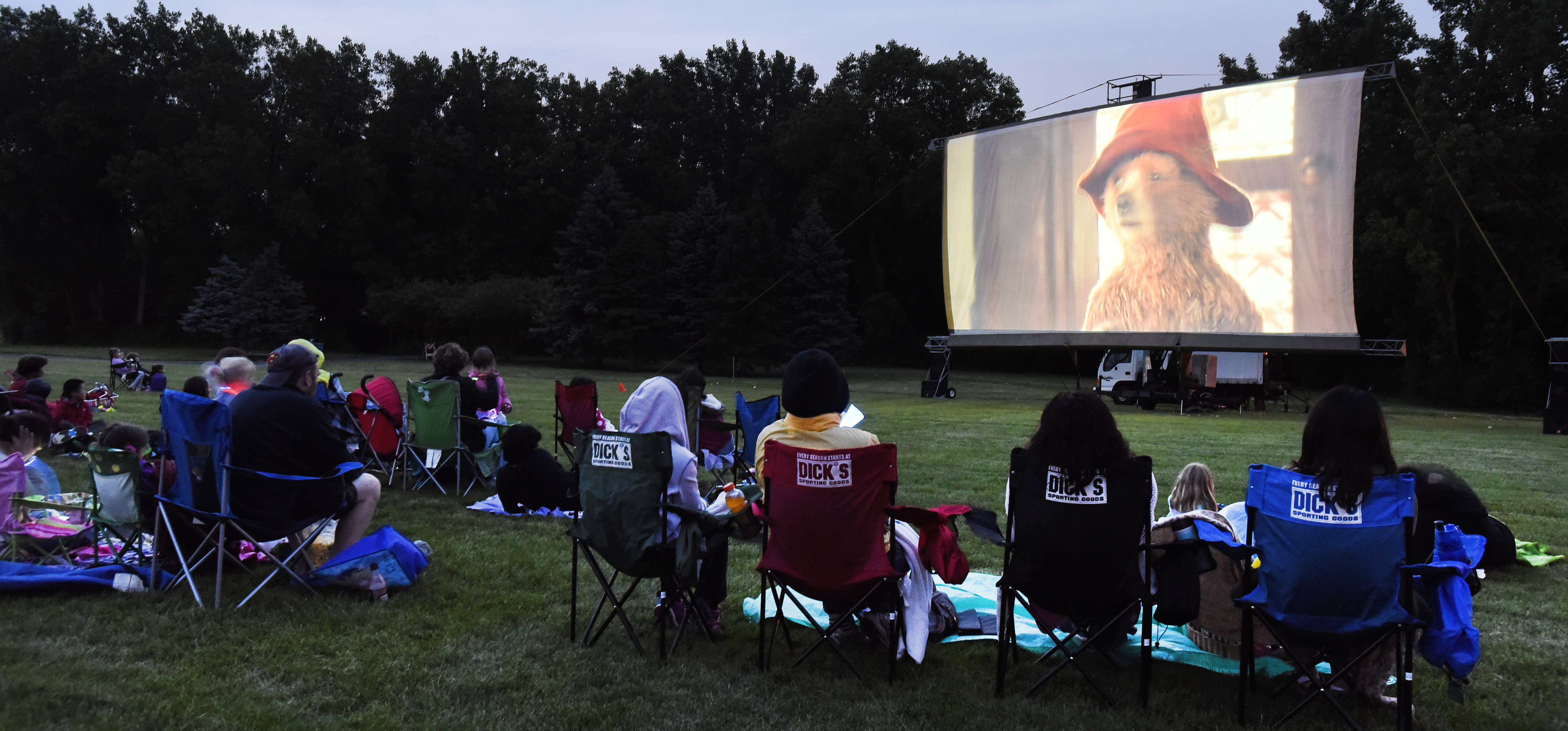 "A crowd watches ""Paddington"" on an outdoor screen at Willow Stream Park in Buffalo Grove. This year, the Buffalo Grove Park District will show ""The Nut Job"" on July 6 and ""Sherlock Gnomes"" on July 27."