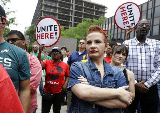 Amanda Hammock, center, a Delaware County, Pa. Democratic party activist, is dressed as Rosie the Riveter as she attends a protest by Philadelphia Council AFL-CIO Wednesday, June 27, 2018, in Philadelphia. The protesters denounced Wednesday's U.S. Supreme Court ruling that government workers can't be forced to contribute to labor unions that represent them in collective bargaining, dealing a serious financial blow to organized labor.