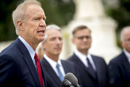 Illinois Gov. Bruce Rauner, left, accompanied by Liberty Justice Center founder and chairman John Tillman, second from left, and Liberty Justice Center's Director of Litigation Jacob Huebert, right, speaks outside the Supreme Court after the court rules in a setback for organized labor that states can't force government workers to pay union fees, in Washington, Wednesday, June 27, 2018.