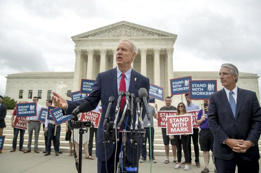 Illinois Gov. Bruce Rauner, center, accompanied by Liberty Justice Center founder and chairman John Tillman, right, speaks outside the Supreme Court after the court rules in a setback for organized labor that states can't force government workers to pay union fees, at the Supreme Court in Washington, Wednesday, June 27, 2018.