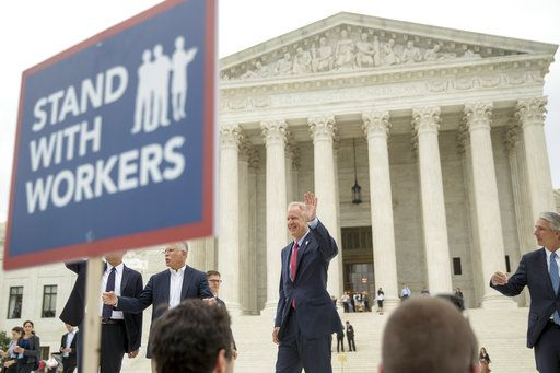 From left, plaintiff Mark Janus, Illinois Gov. Bruce Rauner, and Liberty Justice Center founder and chairman John Tillman, walk out of the the Supreme Court after the court rules in a setback for organized labor that states can't force government workers to pay union fees in Washington, Wednesday, June 27, 2018.
