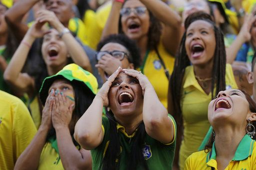 Brazilian soccer fans react as they watch a live telecast of her team's World Cup match against Serbia, at Praca Maua, in Rio de Janeiro, Brazil, Wednesday, June 27, 2018. Brazil wn 2-0.