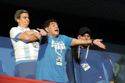 Argentina former soccer star Diego Maradona waves to the fans ahead of the group D match between Argentina and Nigeria, at the 2018 soccer World Cup in the St. Petersburg Stadium in St. Petersburg, Russia, Tuesday, June 26, 2018.