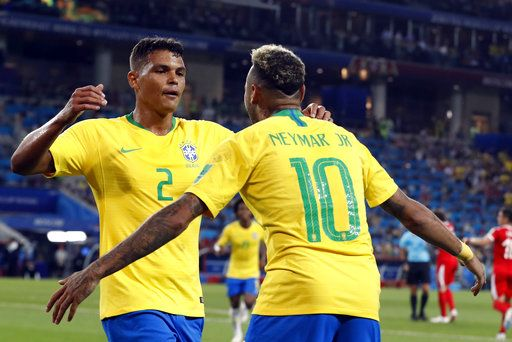 Brazil's Thiago Silva, left, celebrates with teammate Neymar after scoring his side's second goal during the group E match between Serbia and Brazil, at the 2018 soccer World Cup in the Spartak Stadium in Moscow, Russia, Wednesday, June 27, 2018.