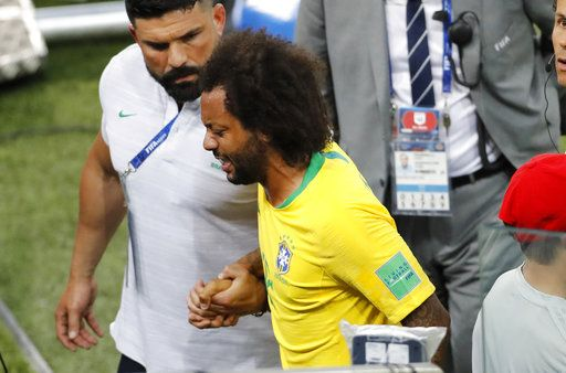 Brazil's Marcelo leaves the pitch after suffering an injury during the group E match between Serbia and Brazil, at the 2018 soccer World Cup in the Spartak Stadium in Moscow, Russia, Wednesday, June 27, 2018.