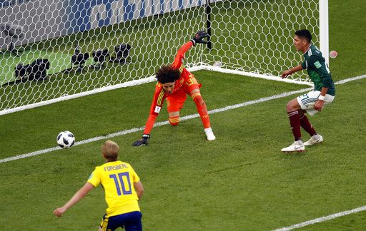 Mexico's Edson Alvarez, right, scores an own goal past his goalkeeper during the group F match between Mexico and Sweden, at the 2018 soccer World Cup in the Yekaterinburg Arena in Yekaterinburg , Russia, Wednesday, June 27, 2018.