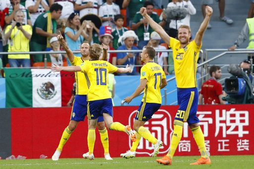 Sweden's team players celebrate after Ludwig Augustinsson, left, scored a penalty, their side's first goal during the group F match between Mexico and Sweden, at the 2018 soccer World Cup in the Yekaterinburg Arena in Yekaterinburg , Russia, Wednesday, June 27, 2018.