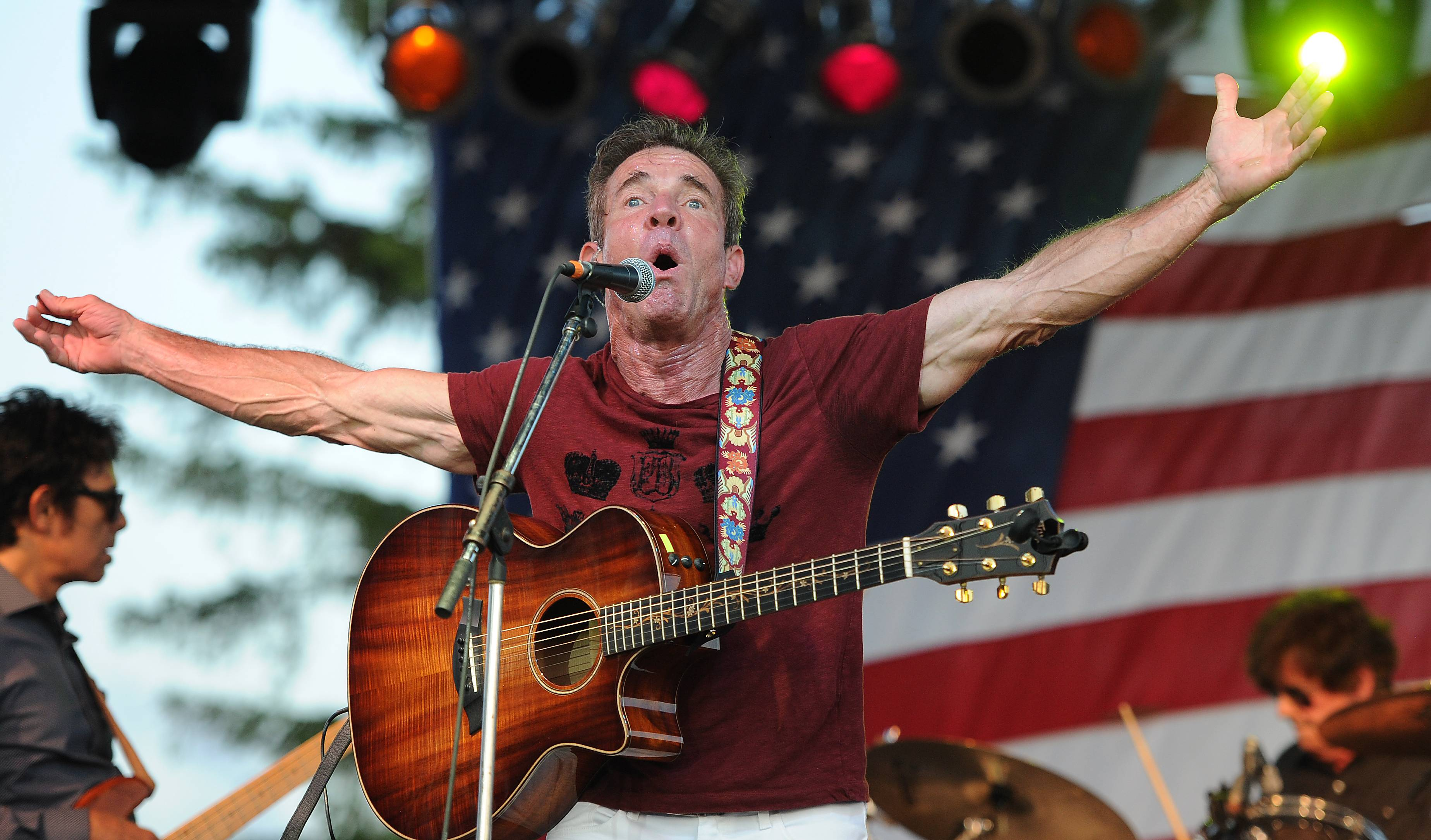 Actor and singer Dennis Quaid plays to a packed house at the Dennis Quaid and the Sharks concert to kick off Frontier Days in Arlington Heights on Friday.