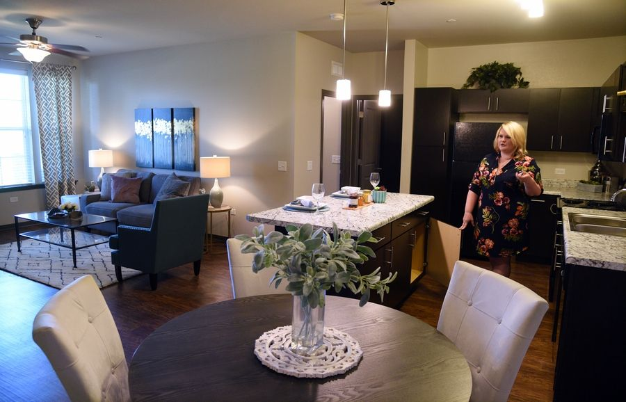 Community manager Kelsey Sheehan shows the features of a two-bedroom apartment at the Springs at Canterfield development in West Dundee.