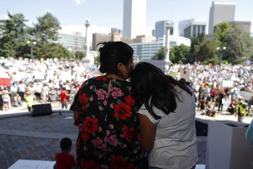 Brenda Villa, left, comforts her 11-year-old daughter, Kathryn, after speaking during an immigration rally and protest in Civic Center Park Saturday, June 30, 2018, in downtown Denver. The protest was one of hundreds staged nationwide that has brought liberal activists, parents and first-time protesters--motivated by accounts of children separated from their parents at the US-Mexico border--to press President Donald Trump to reunite families quickly.