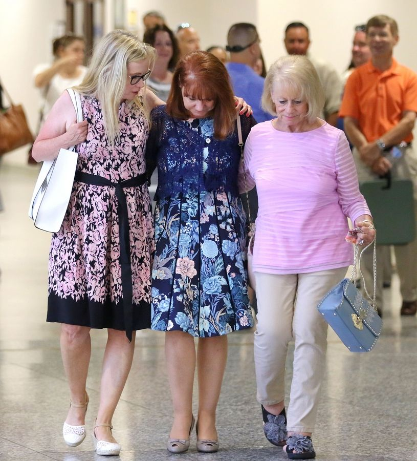 From left, Stephanie Tabak, Karen Mezera and Donna Haggerton leave the courtroom Monday after a jury found Donnie Rudd guilty murdering his wife, Noreen Kumeta, 45 years ago. Mezera and Haggerton, Kumeta's sisters, credit Tabak with getting the case re-examined after four decades.