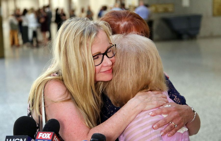 From left, Stephanie Tabak, Karen Mezera and Donna Haggerton hug Monday after a jury found Donnie Rudd guilty of murdering his wife, Noreen Kumeta, 45 years ago. Mezera and Haggerton, Kumeta's sisters, credit Tabak with getting the case re-examined after four decades.