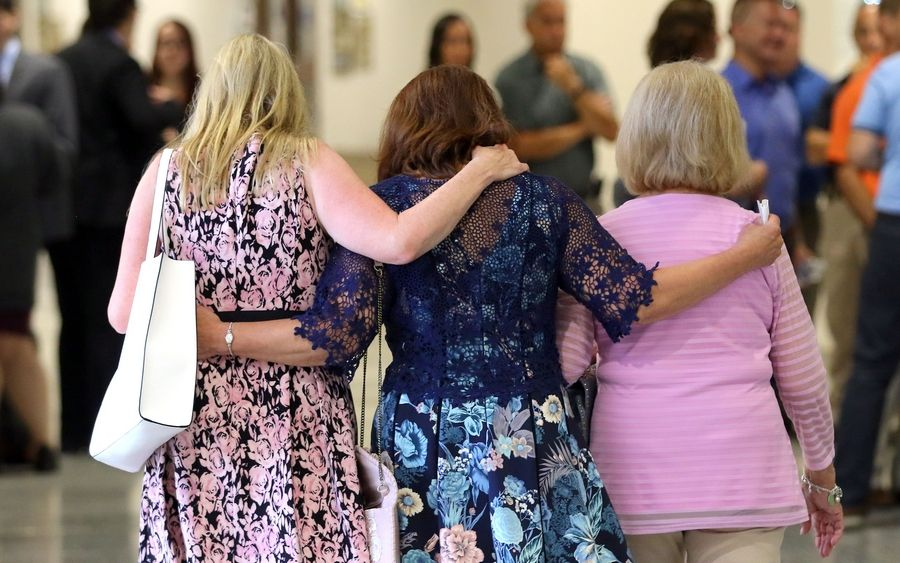 "From left, Stephanie Tabak, Karen Mezera and Donna Haggerton walk arm-in-arm Monday after a jury found Donnie Rudd guilty of murdering his wife, Noreen Kumeta, in 1973. ""It gives me satisfaction just to know he's going to prison."""