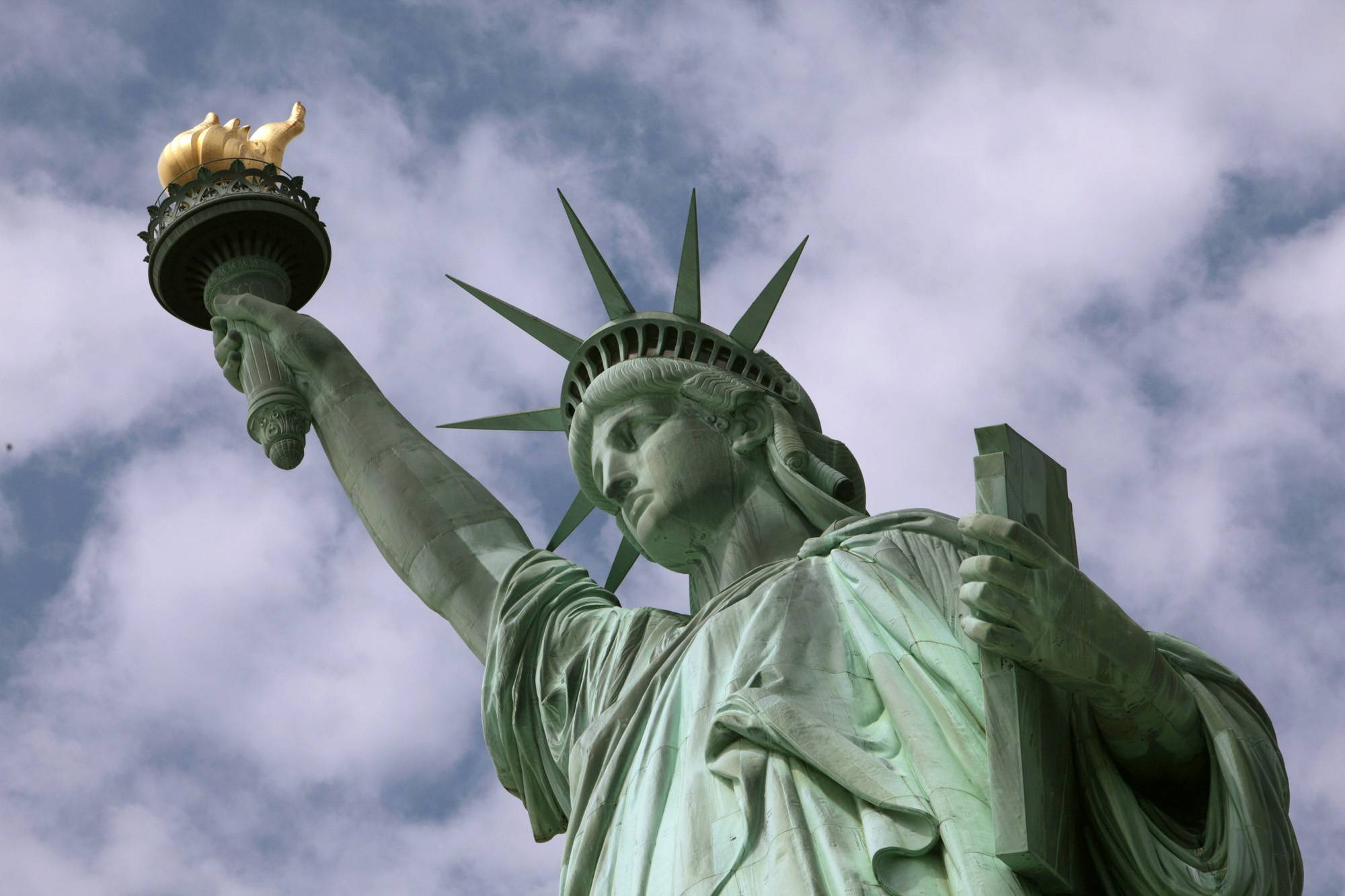 "Dedicated in 1886, the Statue of Liberty in New York Harbor quickly became a symbol of our country's willingness to welcome strangers to our ""Nation of Immigrants."" But we've been struggling with how best to do that since the 18th century."