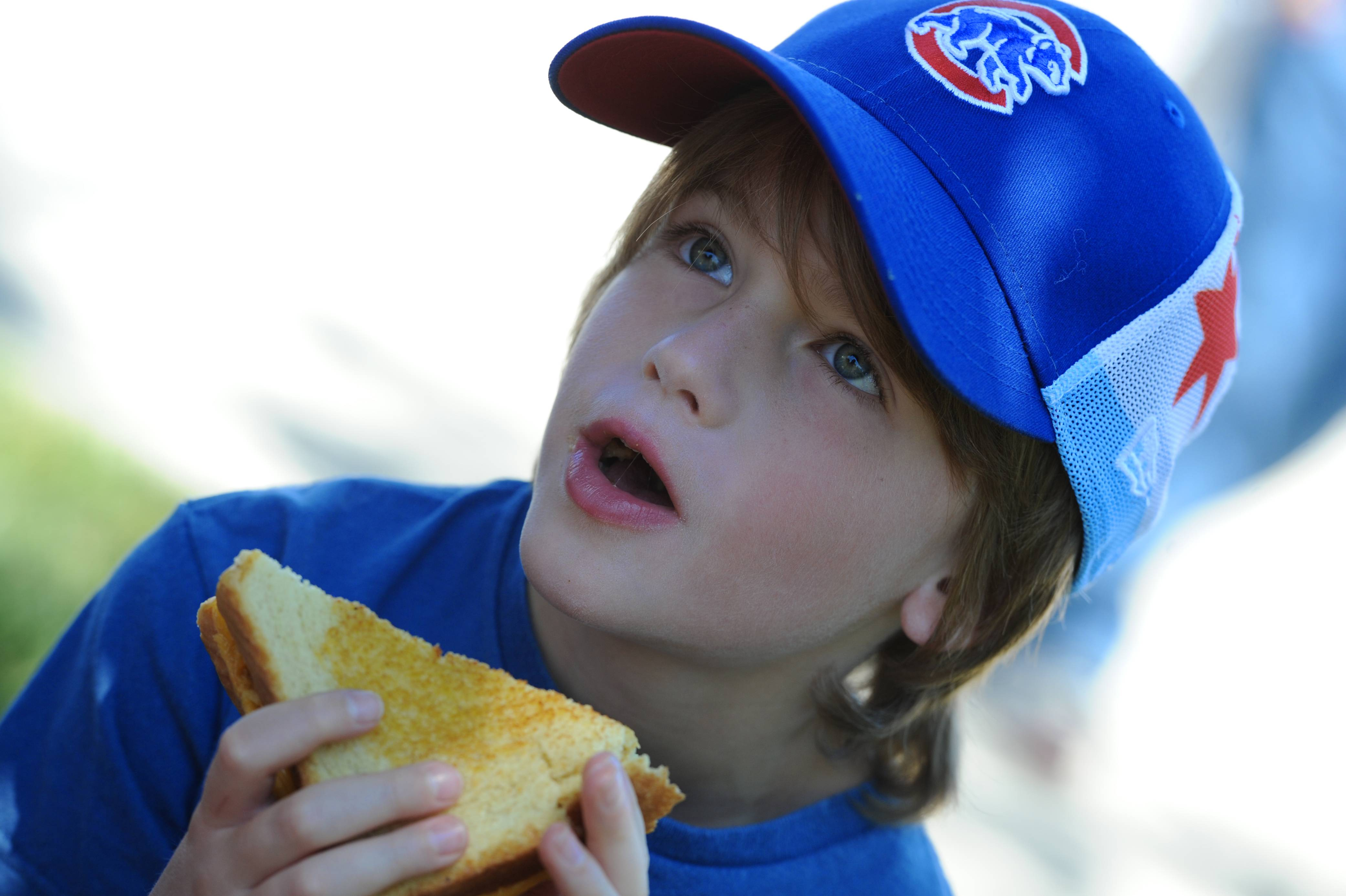 Nolan Diederich, 8, of Arlington Heights tries The Mac -- macaroni and cheese on Texas toast -- at the 5th annual Food Truck Festival Saturday at Arlington Park.