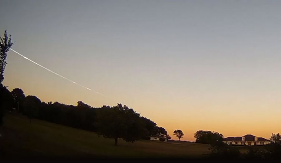A meteor leaves a contrail after streaking across the early night sky in the frame from a video shot by Dan Bush in Albany, Missouri. The meteor was reported by several people who saw it in suburban Chicago.