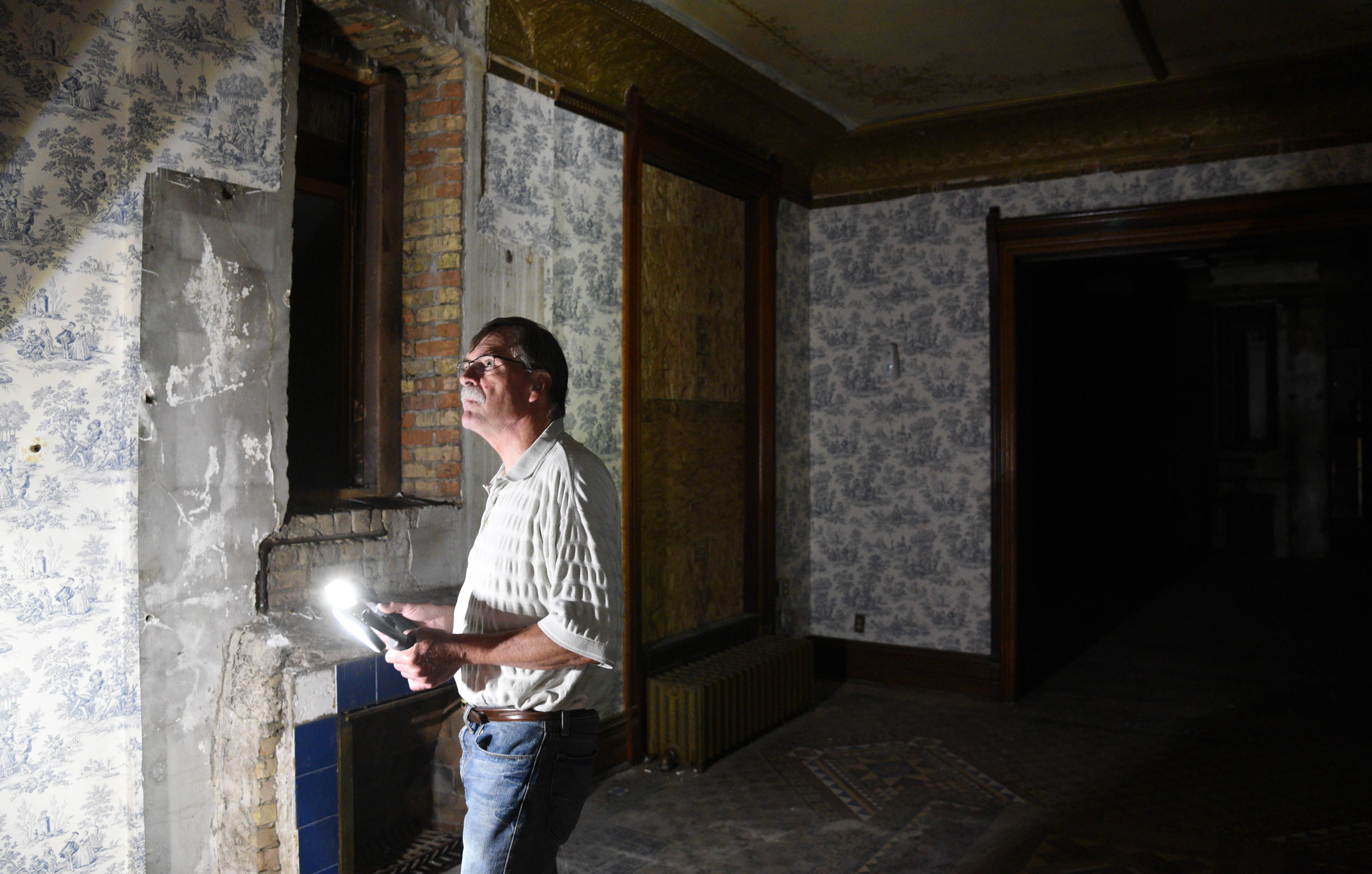 Dan Miller, president of the Gifford Park Association of Elgin, shows off some of the original features of the David C. Cook mansion.