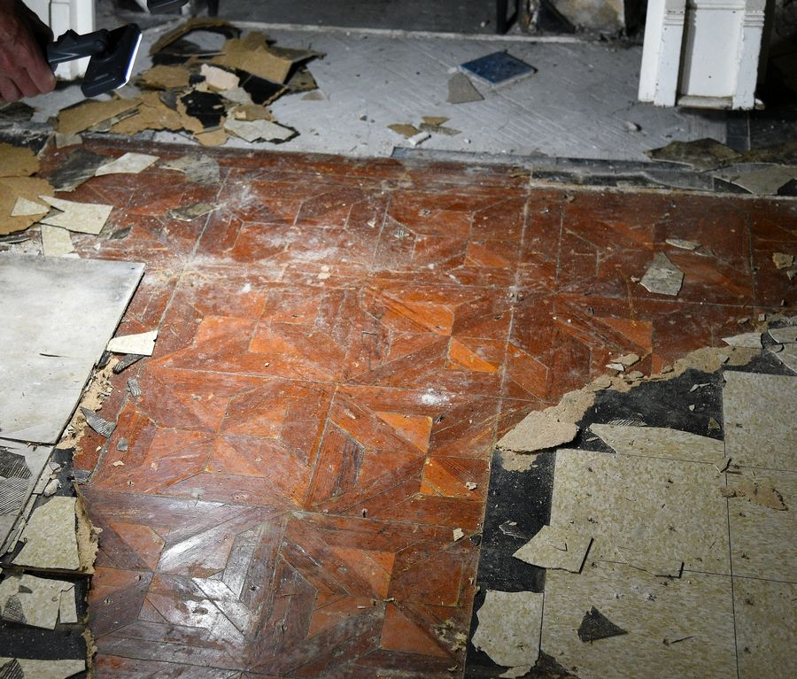 Inlaid wood floors were found under other layers of flooring at the historic David C. Cook mansion in Elgin.