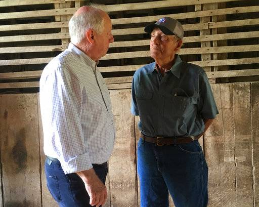 In this June 14, 2018, photo, Democratic U.S. Senate candidate and former Gov. Phil Bredesen, left, talks with David Womack, a farmer and former American Soybean Development Foundation president, during a visit to Farrar Farm in Flat Creek, Tenn. Trade and tariff concerns are roiling high-profile Senate contests across Tennessee, Missouri, Indiana, Pennsylvania and even North Dakota _ states where Republican candidates are being forced to answer for the trade policies of a Republican president they have rallied behind on virtually every other major issue. Bredesen faces Rep. Marsha Blackburn, R-Tenn., in the November election for the seat of retiring Republican Sen. Bob Corker.