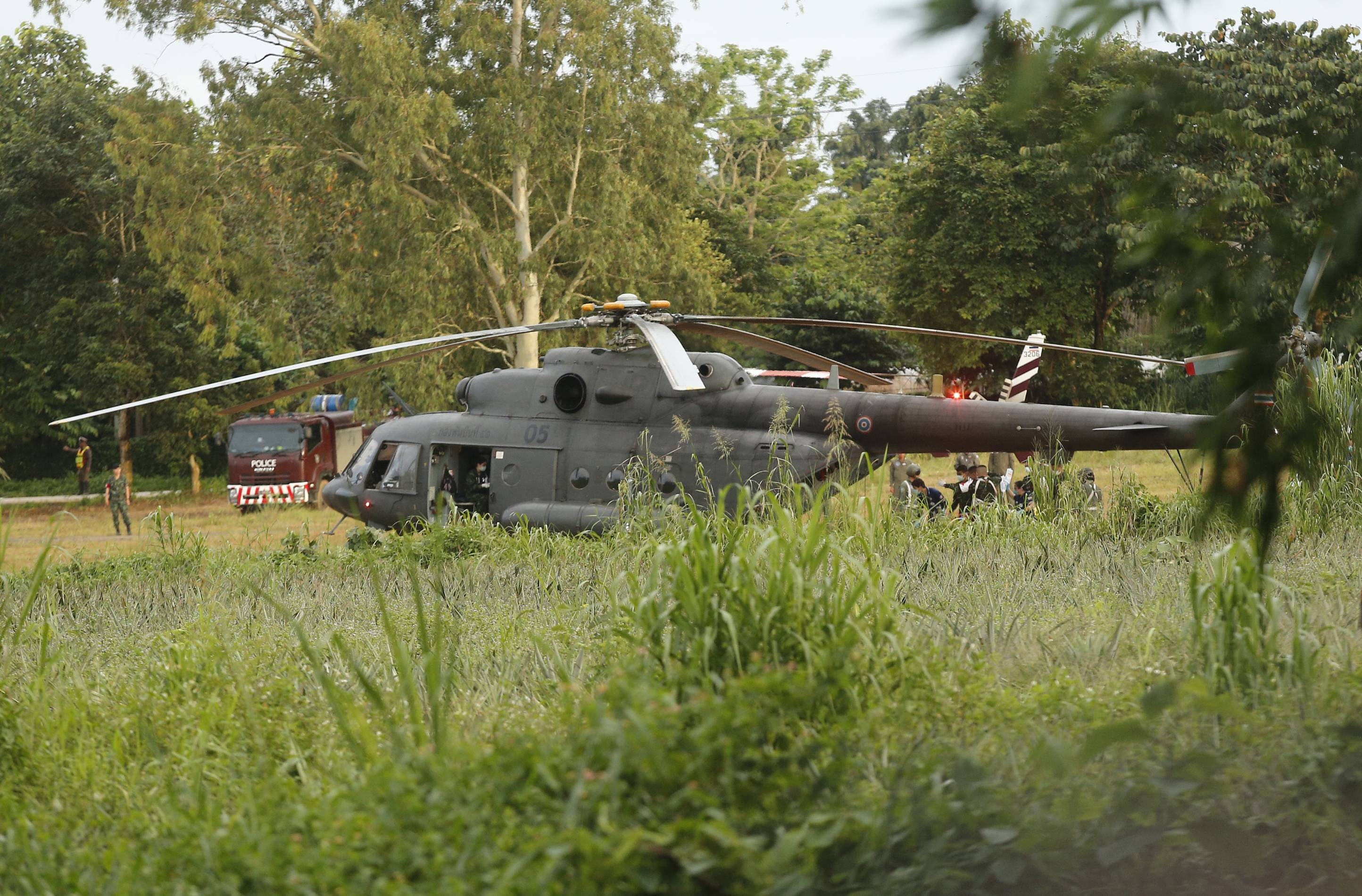 A Thai military evacuation helicopter near a cave in Mae Sai, Chiang Rai province, northern Thailand. Thai Navy SEALs say all 12 boys and their coach have been rescued from the cave, ending an ordeal that lasted more than 2 weeks.