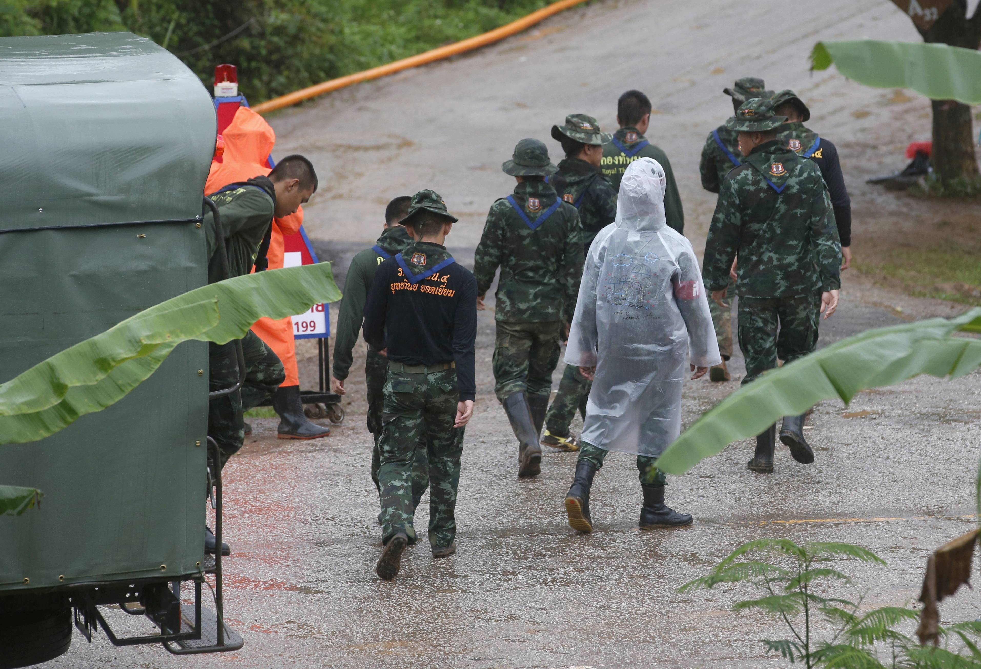Rescuers move Tuesday to the entrance to a cave complex in Mae Sai, Chiang Rai province, northern Thailand.