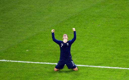 France's Antoine Griezmann celebrates at the end of the semifinal match between France and Belgium at the 2018 soccer World Cup in the St. Petersburg Stadium in St. Petersburg, Russia, Tuesday, July 10, 2018.