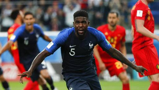 France's Samuel Umtiti celebrates after scoring his sides 1st goal of the game during the semifinal match between France and Belgium at the 2018 soccer World Cup in the St. Petersburg Stadium in, St. Petersburg, Russia, Tuesday, July 10, 2018.