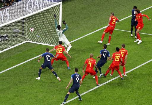 France's Samuel Umtiti, 2nd right, scores the opening goal during the semifinal match between France and Belgium at the 2018 soccer World Cup in the St. Petersburg Stadium in St. Petersburg, Russia, Tuesday, July 10, 2018.
