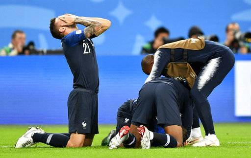 France's Lucas Hernandez, left, celebrates after his team advanced to the final after the semifinal match between France and Belgium at the 2018 soccer World Cup in the St. Petersburg Stadium in St. Petersburg, Russia, Tuesday, July 10, 2018.