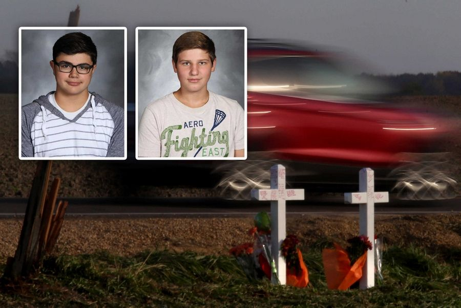Crosses were placed where two 16-year-old Kaneland High School students, Arthur Stenger and Elijah Vajgert, were killed in a crash at Meredith and Beith roads in Kane County in November 2016. A $3 million settlement recently was reached in the crash.