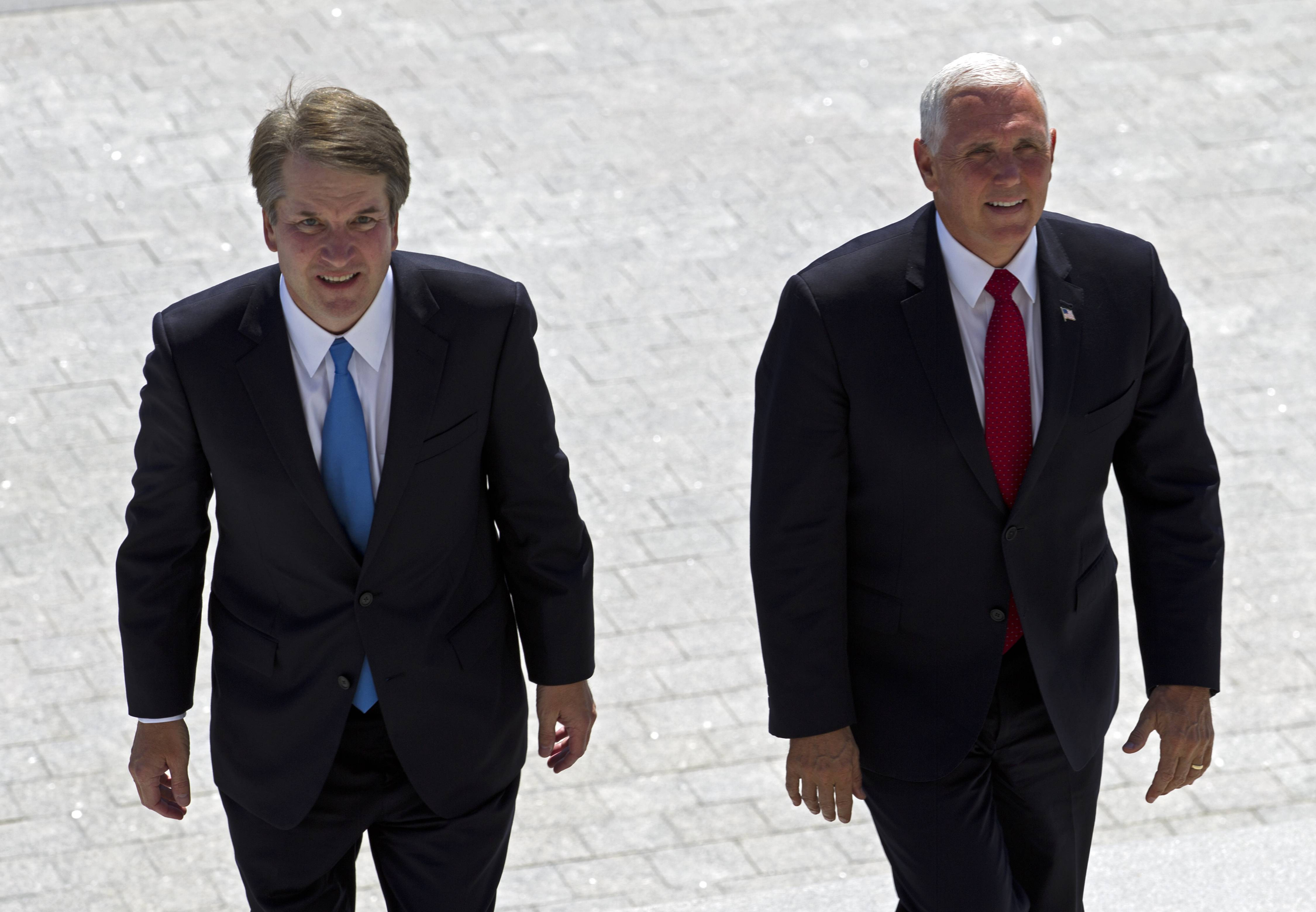 Vice President Mike Pence, right, accompanied by Supreme Court nominee Judge Brett Kavanaugh, arrive at the U.S. Capitol in Washington on Tuesday, July 10, 2018.