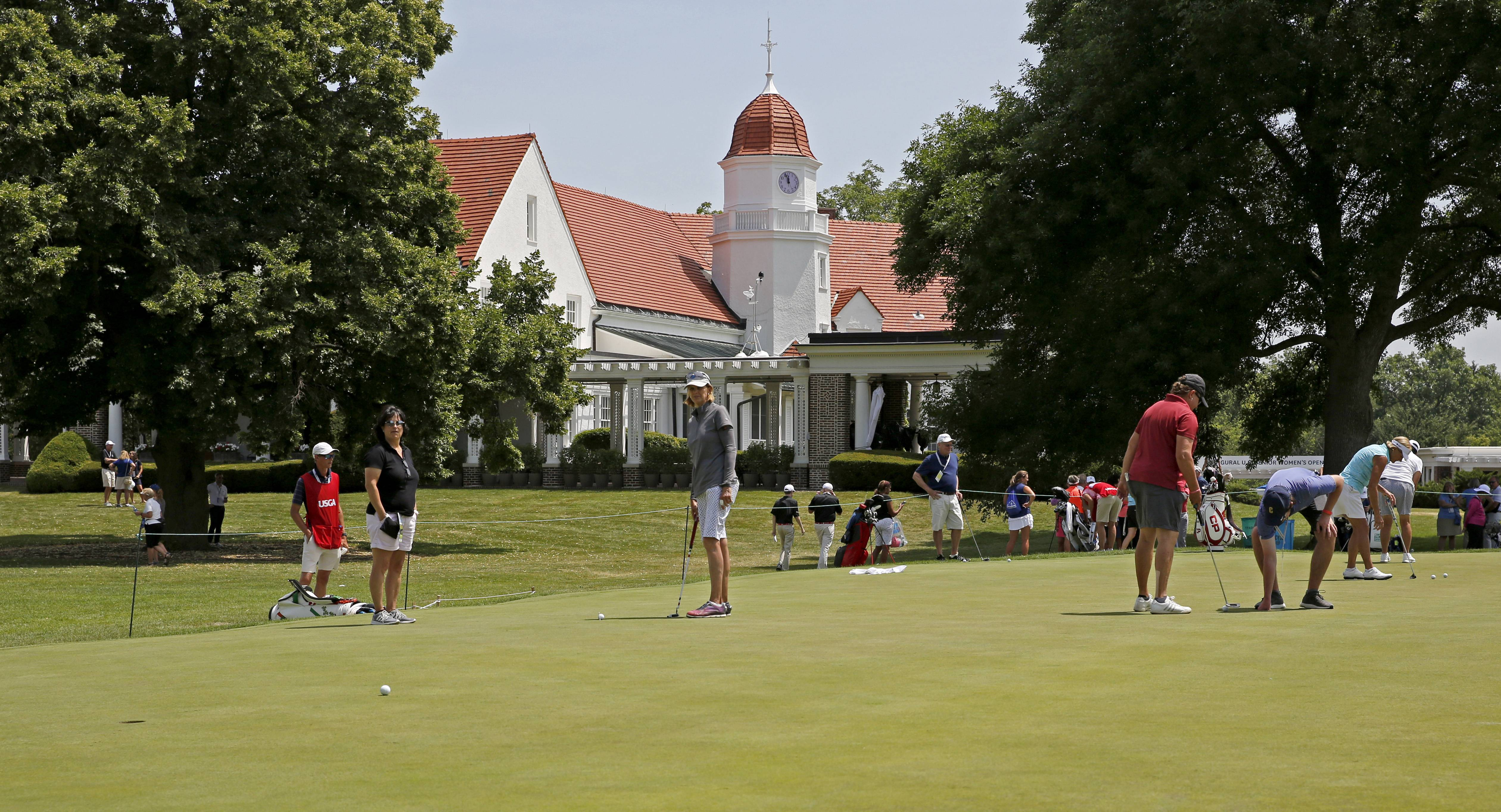 Daniel White/dwhite@dailyherald.comWomen golfers practice their putting for the inaugural U.S. Senior Women's Open at the Chicago Golf Club in Wheaton.