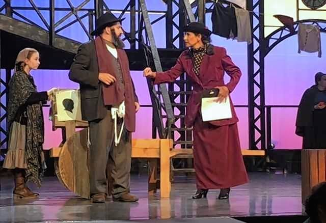 "David Pfenninger as Tateh, Anita Silvert as Emma Goldman and Annie McDonough as Tateh's daughter, in the St. James Parish production of ""Ragtime,"" running through July 22 at the Parish Center, 820 N. Arlington Heights Road, in Arlington Heights."