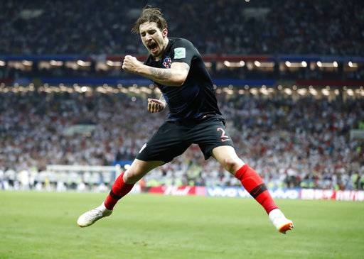 Croatia's Sime Vrsaljko celebrates after his team advanced to the final during the semifinal match between Croatia and England at the 2018 soccer World Cup in the Luzhniki Stadium in Moscow, Russia, Wednesday, July 11, 2018.
