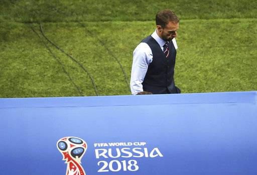 England head coach Gareth Southgate leaves the field at the end of the semifinal match between Croatia and England at the 2018 soccer World Cup in the Luzhniki Stadium in Moscow, Russia, Wednesday, July 11, 2018.