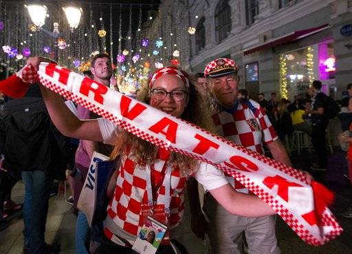 Croatia fans celebrate their team victory after the semifinal soccer match between Croatia and England during the 2018 soccer World Cup in Nikolskaya street near the Kremlin in Moscow, Russia, Thursday, July 12, 2018.