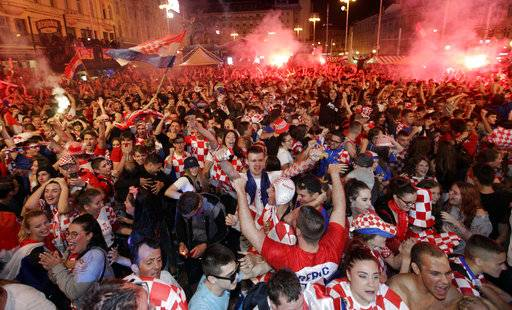 Croatian fans celebrate at the end of the semifinal match between Croatia and England, in Zagreb, Croatia, Wednesday, July 11, 2018.