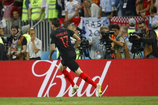Croatia's Mario Mandzukic celebrates after scoring his side's second goal during the semifinal match between Croatia and England at the 2018 soccer World Cup in the Luzhniki Stadium in Moscow, Russia, Wednesday, July 11, 2018.