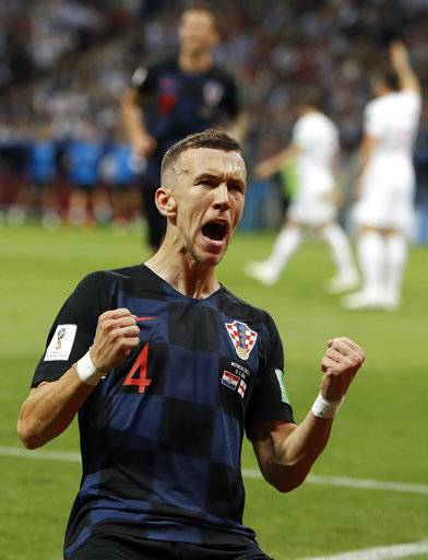 Croatia's Ivan Perisic celebrates after scoring his side's first goal during the semifinal match between Croatia and England at the 2018 soccer World Cup in the Luzhniki Stadium in Moscow, Russia, Wednesday, July 11, 2018.