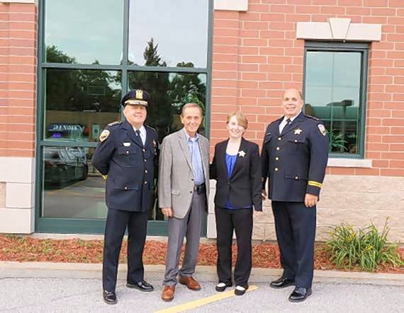 Pictured, from left, are Prospect Heights Police Chief Al Steffen, Prospect Heights Mayor Nicholas J. Helmer, Officer Colleen Zitkus and Deputy Chief of Police Jim Zawlocki.