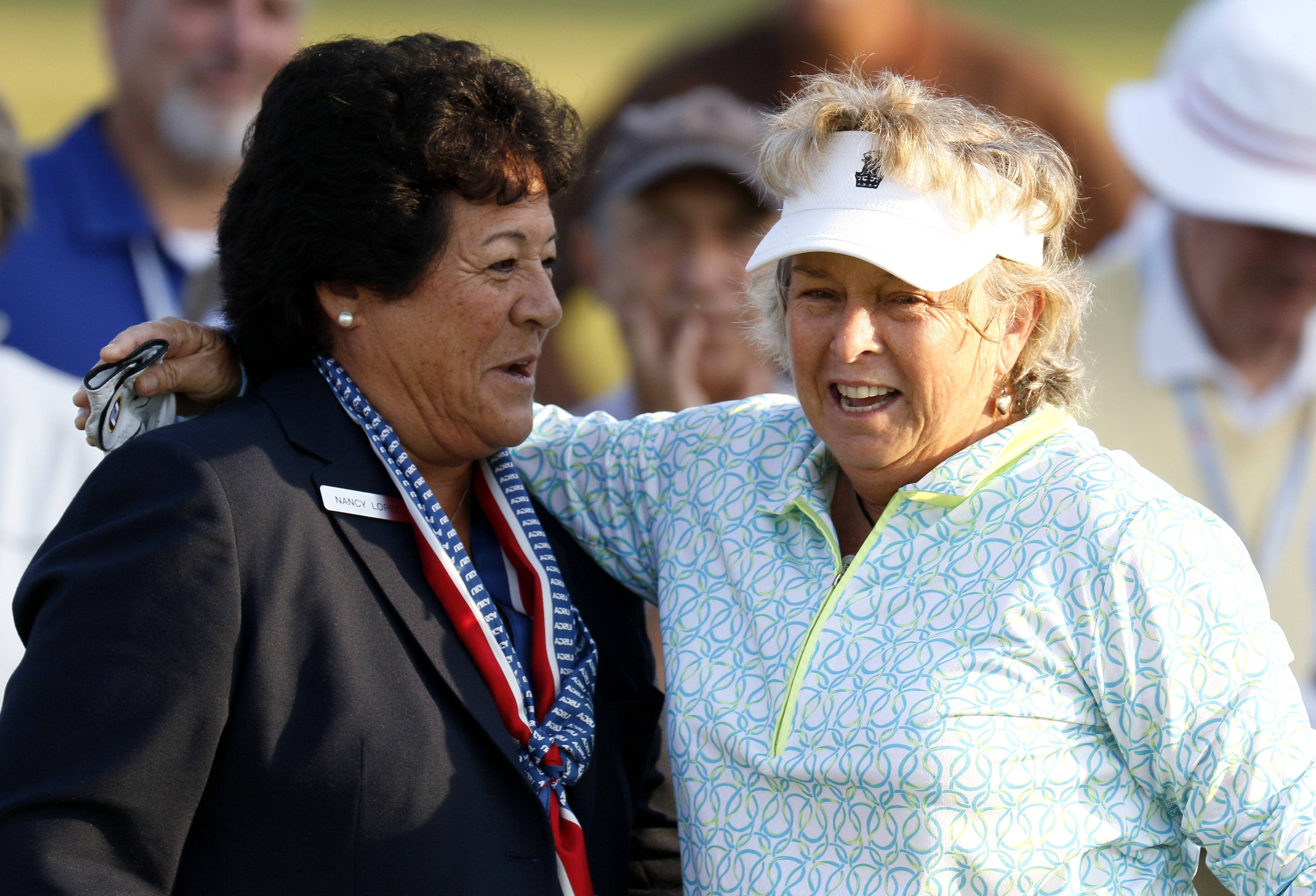 World Golf Hall of Famer Nancy Lopez, left, greets Hollis Stacy, right, at the first tee.