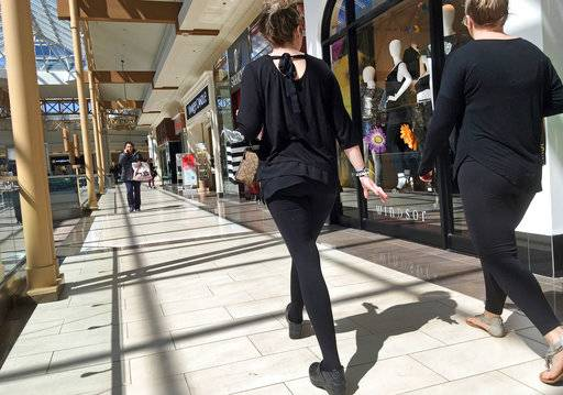 FILE- In this April 9, 2018, file photo, shoppers walk in a mall in Salem, N.H. As Amazon gears up for its Prime Day promotion, other big-name retailers like Macy's and eBay are launching deals and sales of their own. But small businesses, including those that don't sell much online, shouldn't sit on the sidelines.